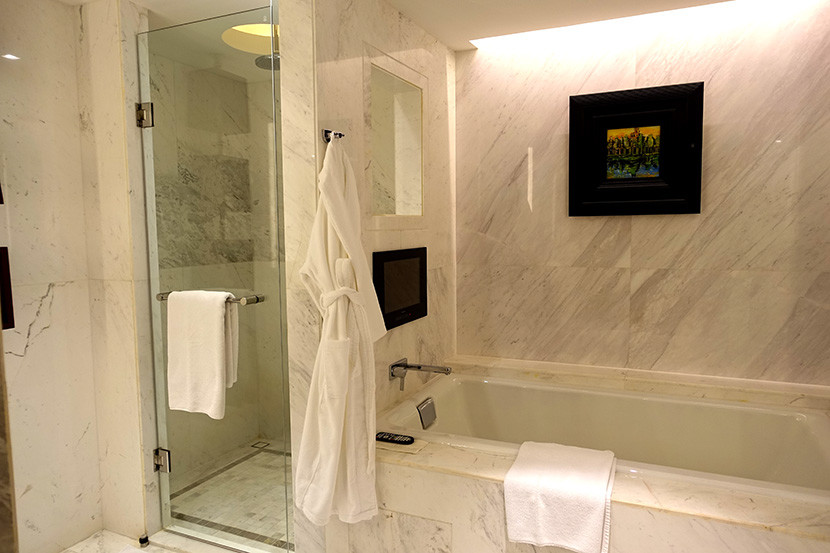 The bathroom has a separate shower and bathtub.