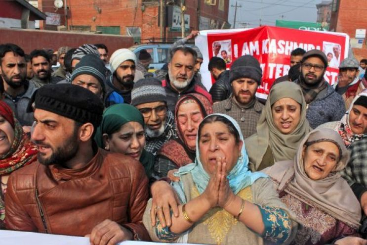 Family of Bilal Ahmed Kawa stage a protest. Credit: PTI