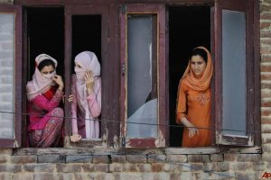 Kashmiri women looking at a rally in Srinagar, 2010. Credit: kashmirglobal/Flickr, CC BY 2.0