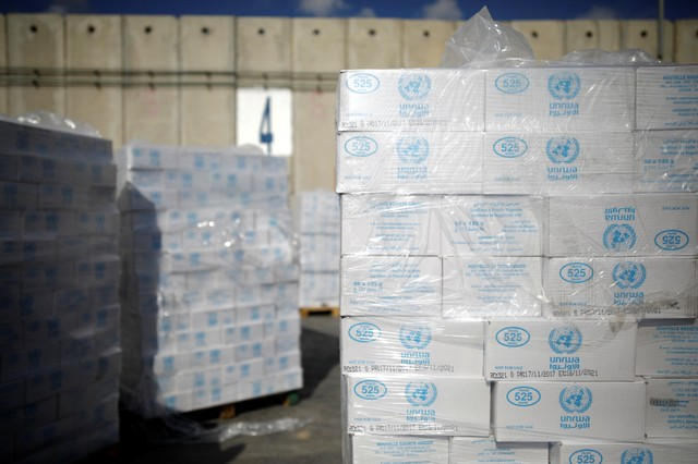 Boxes containing aid from the UN Relief and Works Agency (UNRWA) are seen ahead of their transfer to the Gaza Strip, inside the Kerem Shalom border crossing terminal between Israel and Gaza Strip January 16, 2018. Reuters/Amir Cohen