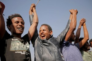 Supporters celebrate as they welcome Merera Gudina, leader of the Oromo Federalist Congress party after his release from prison in Addis Ababa, Ethiopia, January 17, 2018. Credit: Reuters/Tiksa Negeri