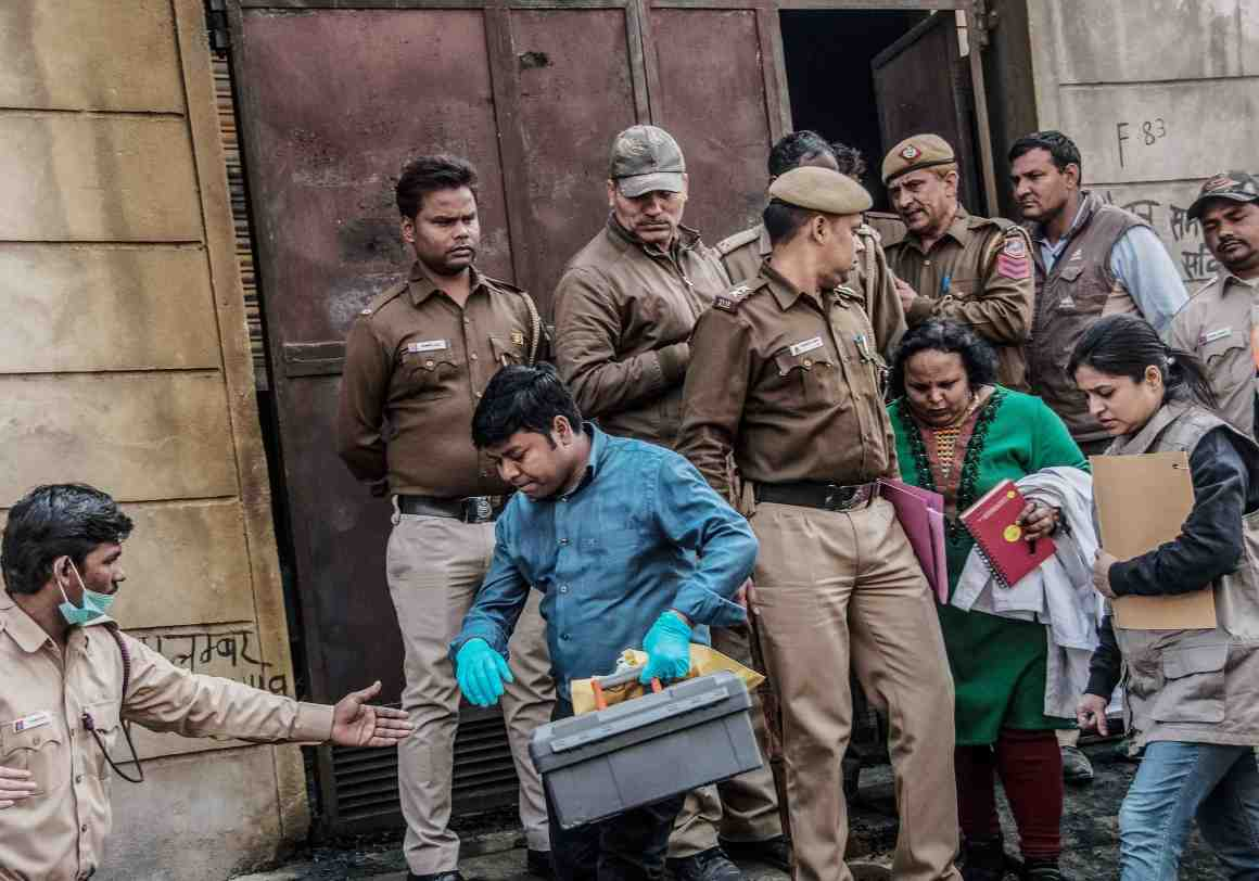 Forensic experts leave after collecting samples from the Bawana firecracker storage unit. Credit: PTI