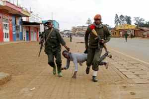 Congolese soldiers arrest anti-government protester in North Kivu province. Credit: Reuters/ Kenny Katombe