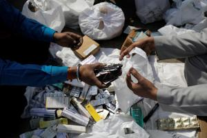 People segregate expired medicines outside a chemist store in New Delhi, India February 2, 2018. Credit: Reuters/Saumya Khandelwal