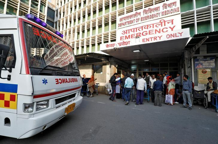 An ambulance arrives as people stand at the entrance of the emergency department of a government-run hospital in New Delhi, India, November 22, 2017. Credit: Reuters/Saumya Khandelwal/File Photo