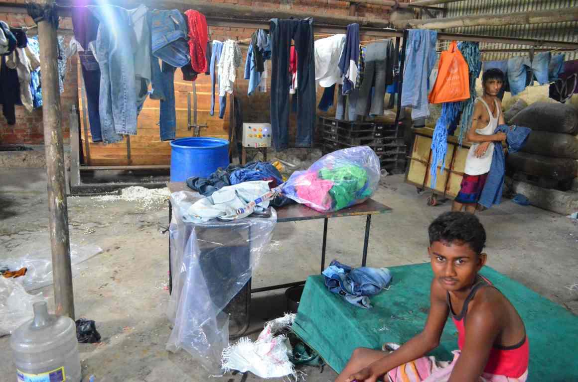 Migrant workers living inside a garment processing unit, Narol, Ahmedabad. Credit: Jagjit Singh