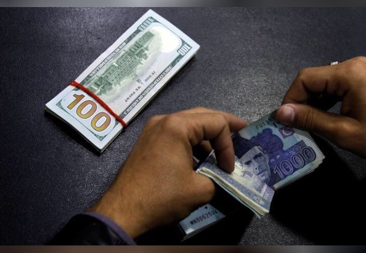 FILE PHOTO - A currency trader counts Pakistani Rupee notes as he prepares an exchange of U.S dollars in Islamabad, Pakistan December 11, 2017. REUTERS/Caren Firouz