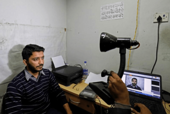 A man goes through the process of eye scanning for the Unique Identification (UID) database system at a registration centre in New Delhi, India, January 17, 2018. Credit: Reuters/Saumya Khandelwal