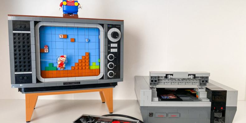 A lego nintendo entertainment system with a controller, next to a lego tv displaying an image from a super mario game.