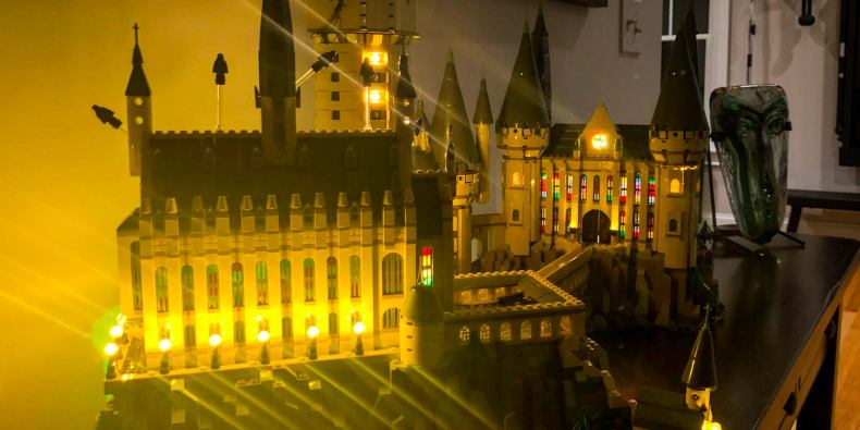 The lego hogwarts castle set, illuminated mostly by tiny, yellow LED lights within the set.