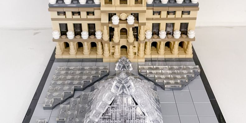 A lego version of the entrance to the louvre, including the glass pyramid in front.