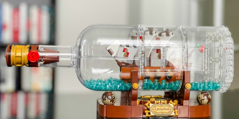 A lego version of a ship in a bottle decorative display.