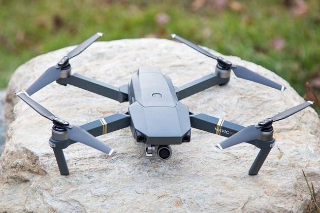 dji mavic pro drone on a boulder outside