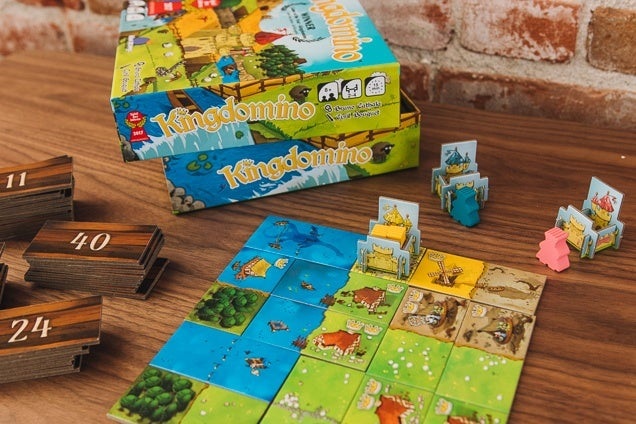 Board Games We Love for Kids  Reviews by Wirecutter   A New York     The Kingdomino children s board game in use on a wooden table