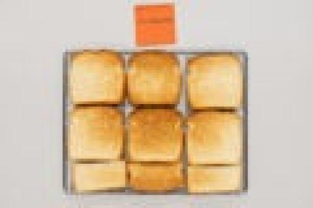 Тост из Кальфалона, выглядящий равномерно поджаренным в середине, но немного бледным по краям.