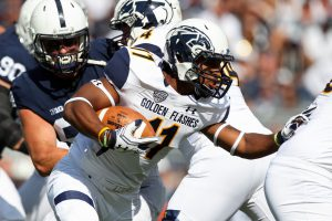 Sep 3, 2016; University Park, PA, USA; Kent State Golden Flashes quarterback Mylik Mitchell (17) runs with the ball during the second quarter against the Penn State Nittany Lions at Beaver Stadium. Penn State defeated Kent State 33-13. Mandatory Credit: Matthew O'Haren-USA TODAY Sports