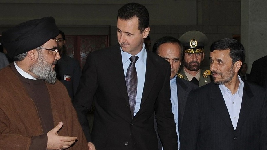 Hezbollah leader sheik Hassan Nasrallah, left, speaks with Syrian President Bashar Assad, center, and Iranian President Mahmoud Ahmadinejad, right, upon their arrival for a dinner in Damascus, Syria, February 25, 2010 (photo credit: AP/SANA)