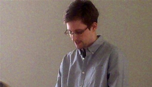 NSA leaker Edward Snowden during his meeting with Russian activists and officials at Sheremetyevo airport, Moscow, Russia, July 12, 2013,  (photo credit: AP Photo/Tatyana Lokshina, Human Rights Watch)