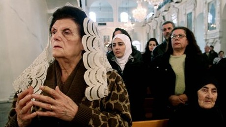 Syrian Christians and Muslims offer prayers for nuns held by rebels, at the Greek Orthodox Mariamiya Church in Damascus, Syria, on Sunday, December 8, 2013. (photo credit: AP)