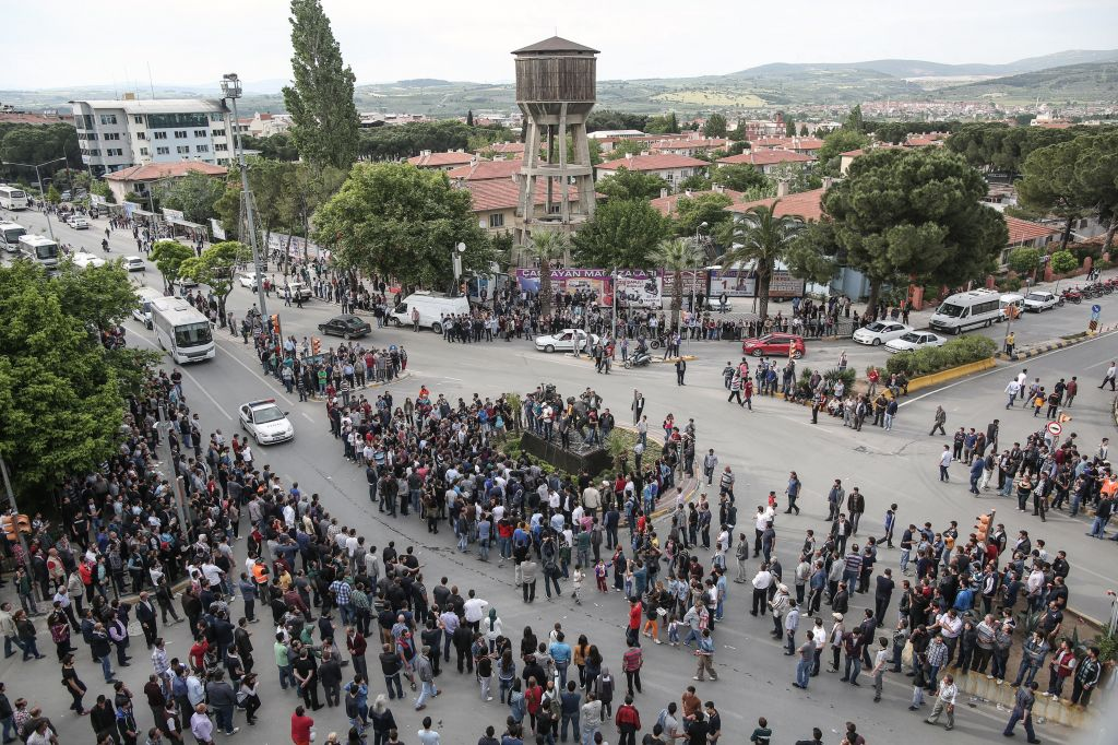 People take to the street and march to the local office of Prime Minister Erdogan's Justice and Development Party in Soma, Turkey, on Wednesday (photo credit: AP/Emrah Gurel)