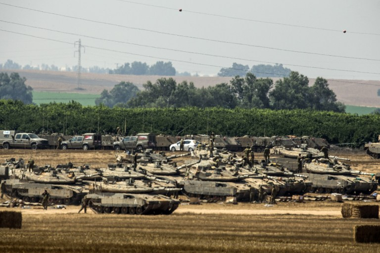 Israeli tanks mass on the Gaza border