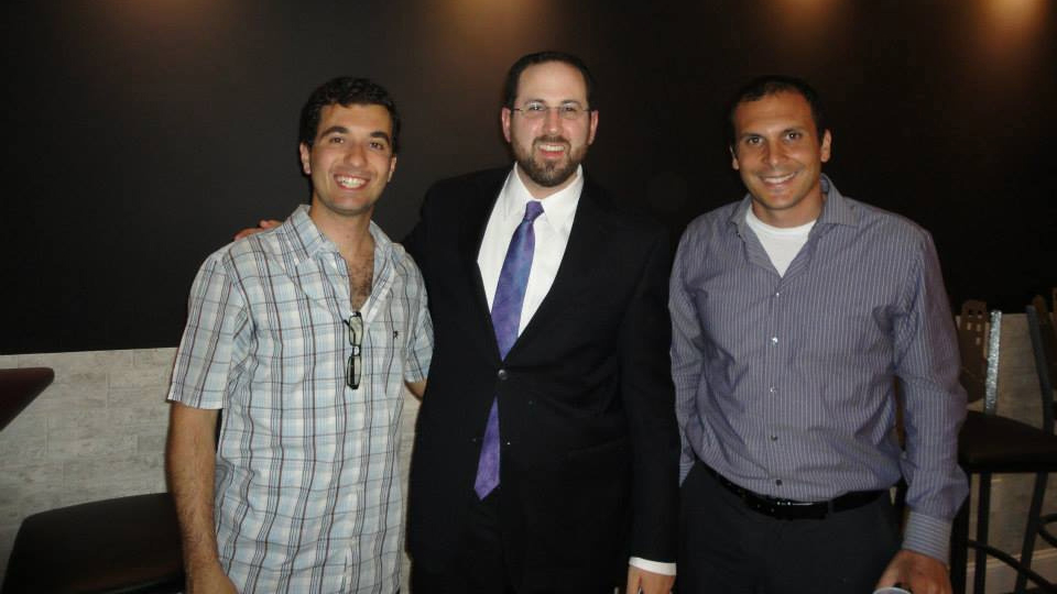 Rabbi Yitzchok Fingerer (middle) with two members of the Brooklyn Jewish Experience. (Courtesy: Brooklyn Jewish Experience)
