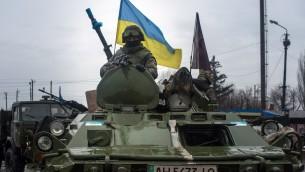 Illustrative: Ukrainian soldiers ride armored vehicles to Debaltseve, eastern Ukraine, Donetsk region, on February 1, 2015. (AFP/Oleksander Stashevsky)