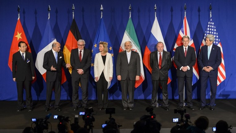 Representatives from world powers and Iran posing prior to the announcement of an agreement on Iran nuclear talks at the The Swiss Federal Institutes of Technology (EPFL) in Lausanne, April 2, 2015. (AFP/FABRICE COFFRINI)