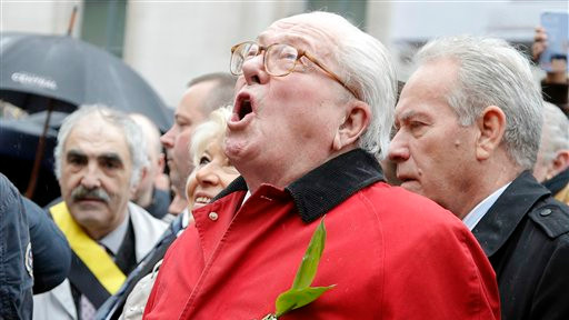 France's far-right National Front party's founder Jean-Marie Le Pen screams 'Help Jeanne d'Arc' after he places a wreath at Joan of Arc's statue during its annual May Day march, in Paris, France, Friday, May 1, 2015 (photo credit: AP/Francois Mori)