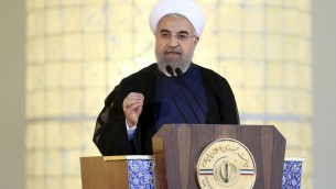Iran's President Hassan Rouhani addressing  the nation after a nuclear agreement was announced in Vienna, in Tehran, Iran, Tuesday, July 14, 2015. (AP Photo/Ebrahim Noroozi)