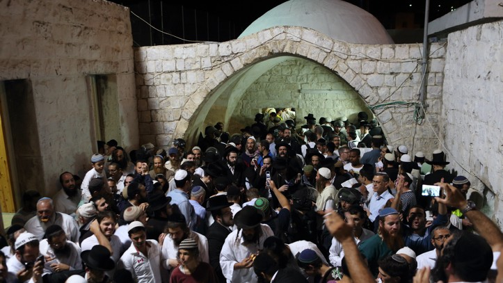 Hundreds of ultra Orthodox Jewish men pray near the compound of Joseph's Tomb in the West Bank city of Nablus early on June 10, 2013. (Yaakov Naumi/Flash90)