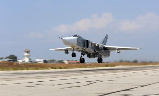 A Russian Sukhoi Su-24 bomber taking off from the Hmeimim airbase in the Syrian province of Latakia. (AFP Photo / Kosomolskaya Pravda / Alexander Kots)
