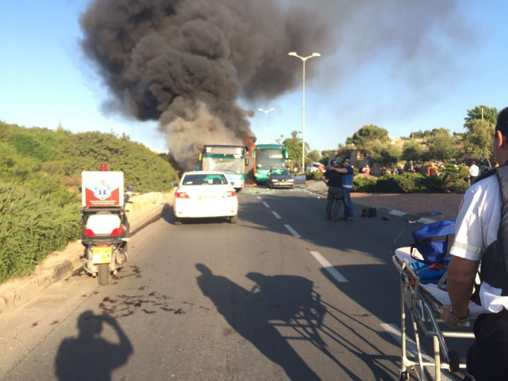 Two burning buses on a Jerusalem street. The cause of the incident was being investigated by police. (Israel police)