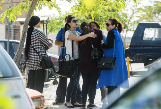 Families of passengers who were flying on board an EgyptAir plane that vanished from radar en route from Paris to Cairo react as they wait outside a services hall at Cairo international airport on May 19, 2016. (AFP PHOTO / KHALED DESOUKI)