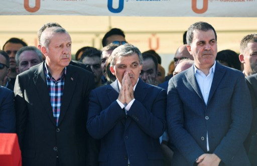 Turkey's President Recep Tayyip Erdogan (L) and former Turkish president Abdullah Gul (C) react after attending the funeral of a victim of the coup attempt in Istanbul on July 17, 2016. (Fethullah Gulen / AFP PHOTO / BULENT KILIC)