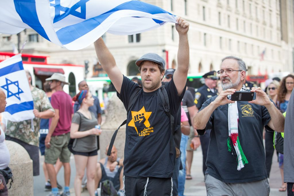 The Boston 'Al-Quds Day' demonstration on July 1, 2016, outside the Boston Public Library in Boston, Massachusetts. Pro-Israel demonstrator Yaniv Baron was one of several Israel supporters to counter-protest the anti-Israel gathering (Elan Kawesch/The Times of Israel)