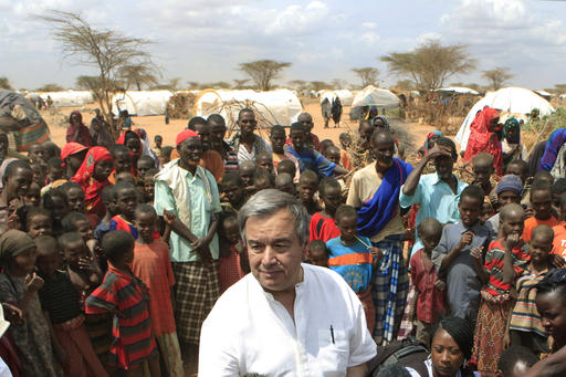 UN High Commissioner for Refugees Antonio Guterres is surrounded by Somali refugees as he speaks to the media in an area where arrivals from Somalia have settled, on the outskirts of Dagahaley Camp, outside Dadaab, Kenya, July 10, 2011. (AP Photo/Rebecca Blackwell, File)