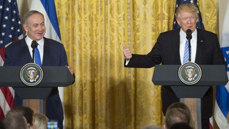 US President Donald Trump, right, and Israeli Prime Minister Benjamin Netanyahu hold a joint press conference in the East Room of the White House on February 15, 2017. (AFP/Saul Loeb)