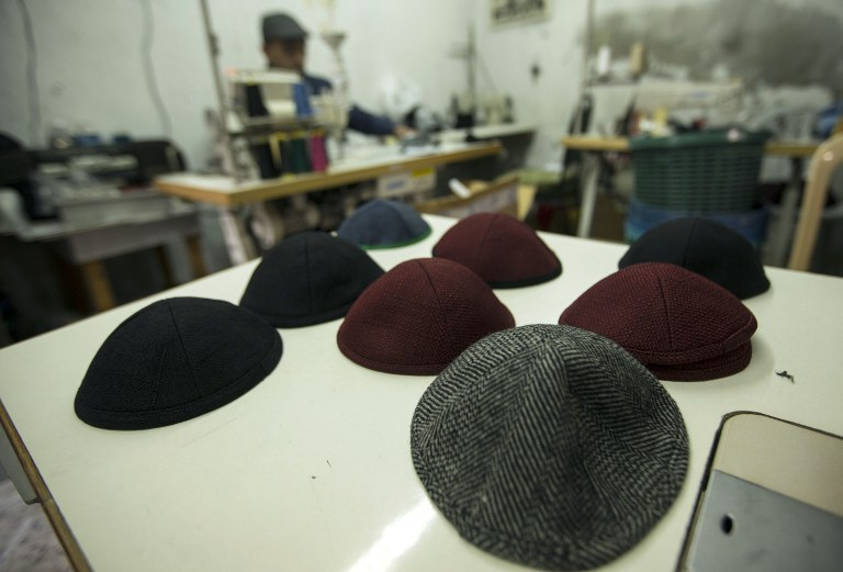A Palestinian man works in a factory in Gaza City making kippot, or Jewish skullcaps, to be exported to Israel, on March 8, 2017. (AFP PHOTO / MAHMUD HAMS)