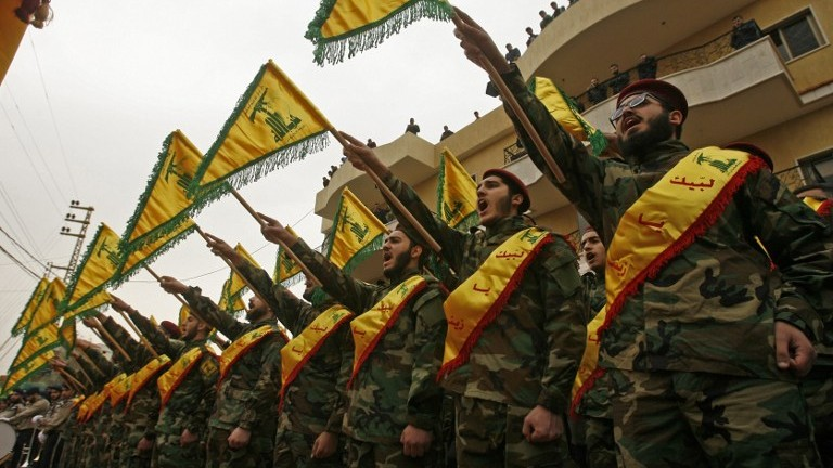 Fighters of the Shiite Hezbollah terror group attend the funeral of a comrade who died in combat in Syria in the southern Lebanese town of Kfar Hatta on March 18, 2017. (AFP Photo/Mahmoud Zayyat)