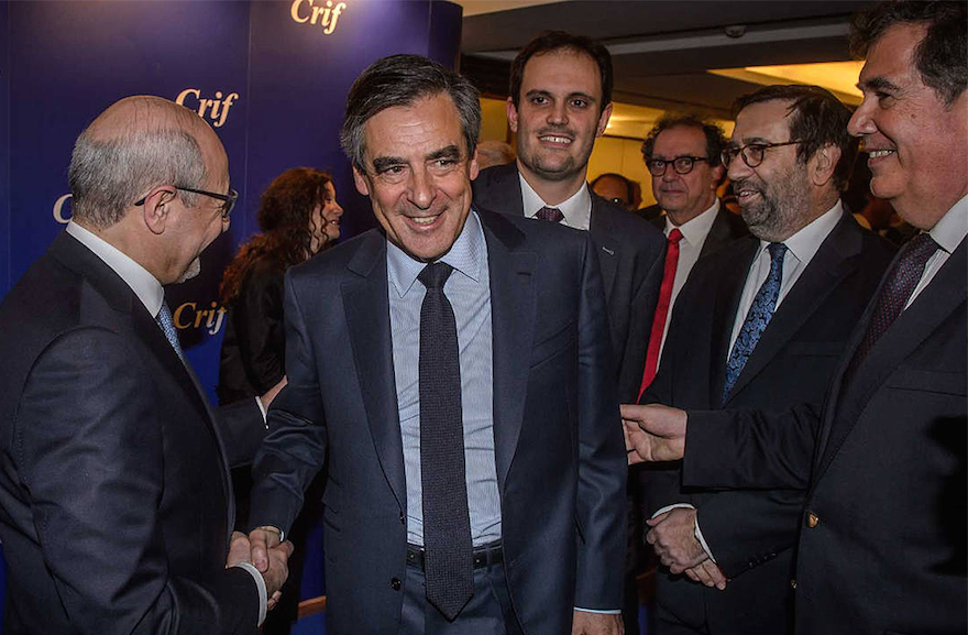 Francois Fillon, with open jacket, shaking hands with CRIF President Francis Kalifat in Paris, March 14, 2017. (Courtesy CRIF via JTA)