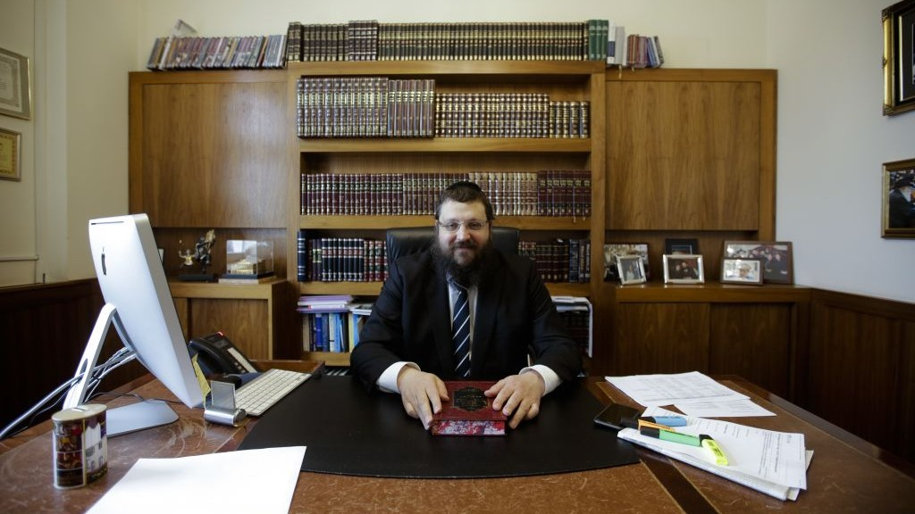Rabbi Yehuda Teichtal sits at his desk during an interview with the Associated Press about the plans for a Jewish Campus in Berlin, Germany, April 3, 2017. (AP Photo/Markus Schreiber)