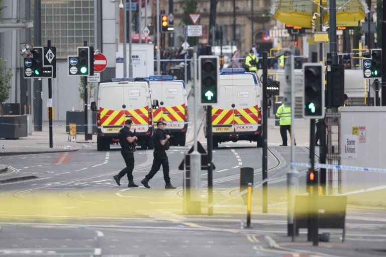 Armed police patrol near Manchester Arena following a deadly terror attack in Manchester, northwest England on May 23, 2017. (AFP/Oli SCARFF)