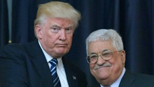 US President Donald Trump, left, and Palestinian leader Mahmoud Abbas pose for a photograph during a joint press conference at the presidential palace in the West Bank city of Bethlehem on May 23, 2017. (AFP/Mandel Ngan)
