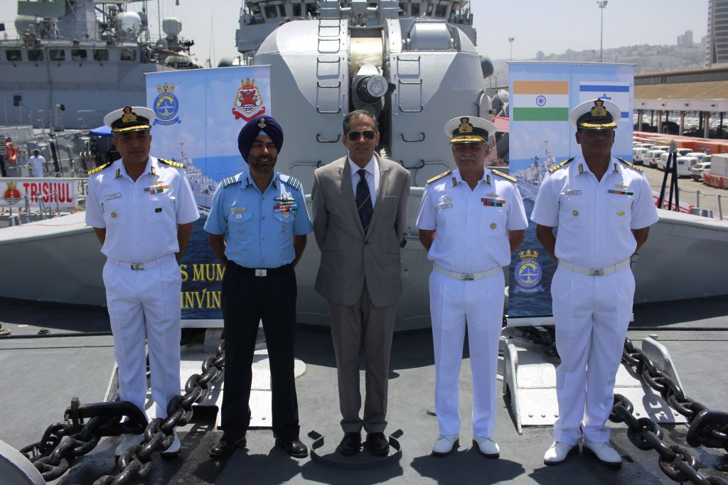 From left, Cpt. Sanjay Sachdeva, Indian defense attache Gp. Cpt. Tejpal Singh, Indian Ambassador Pavan Kapoor, Rear Admiral RB Pandit and Cpt. Sunil Kumar Roy pose for a photograph on board the INS Trishul, docked in Haifa as part of an official visit by the Indian Navy on May 10, 2017. (Judah Ari Gross/Times of Israel)