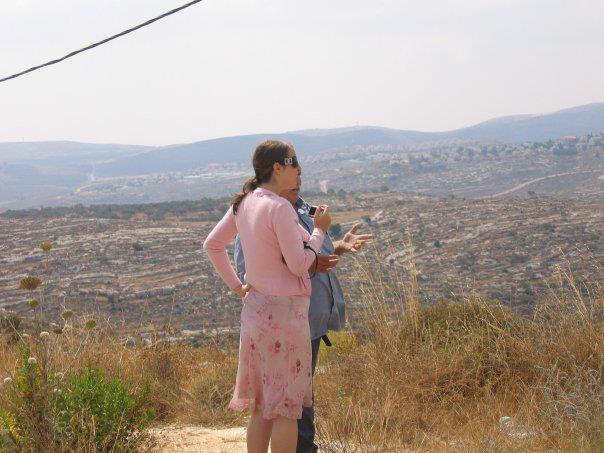 Dr. Sara Yael Hirschhorn speaks with a settler in Shilo during a research trip, circa 2008. (courtesy)