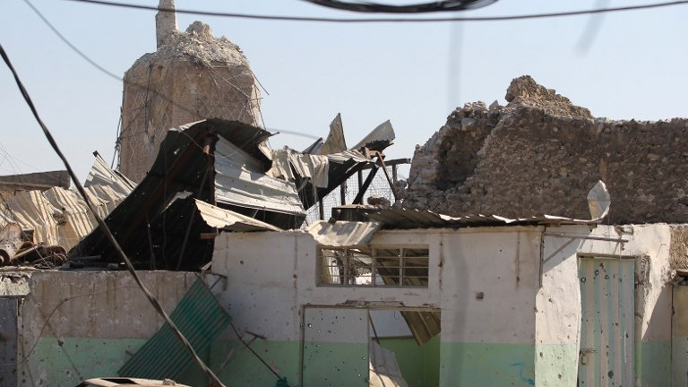 "A picture taken on June 29, 2017, shows Mosul's destroyed ancient leaning minaret, known as the ""Hadba"" (Hunchback), in the Old City of Mosul. (AFP Photo/Ahmad Al-Rubaye)"