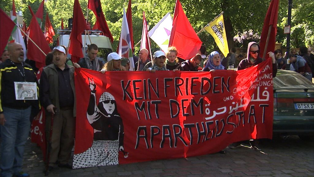 A screenshot from the documentary 'Chosen and Excluded -- Jew Hatred in Europe,' showing a Nakba Day demonstration in Berlin. (Courtesy)