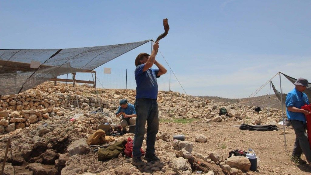 The shofar blast signals the end of the work day at the Shiloh archaeological excavation, July 2017. (courtesy)