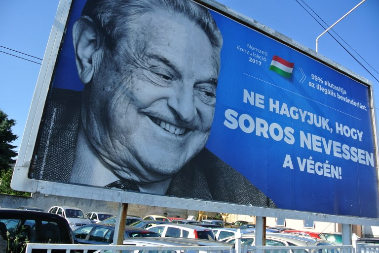 A poster with US billionaire George Soros is pictured on July 6, 2017, in Szekesfehervar, Hungary. (AFP PHOTO / ATTILA KISBENEDEK)